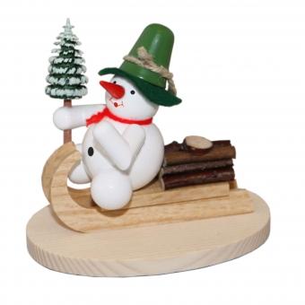 Schneemann auf Holzschlitten